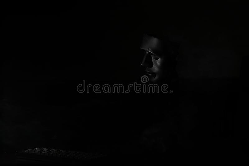 Black mask in the dark ritual and mystery. Black mask in the dark secretive ritual and mysteryr stock photo
