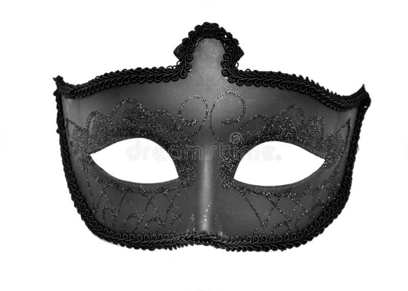 Black mask. Venetian black mask, isolated on a white background stock photo