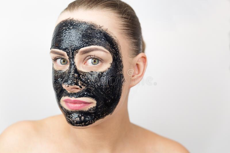 Black mask. Woman with purifying black mask on her face stock photos