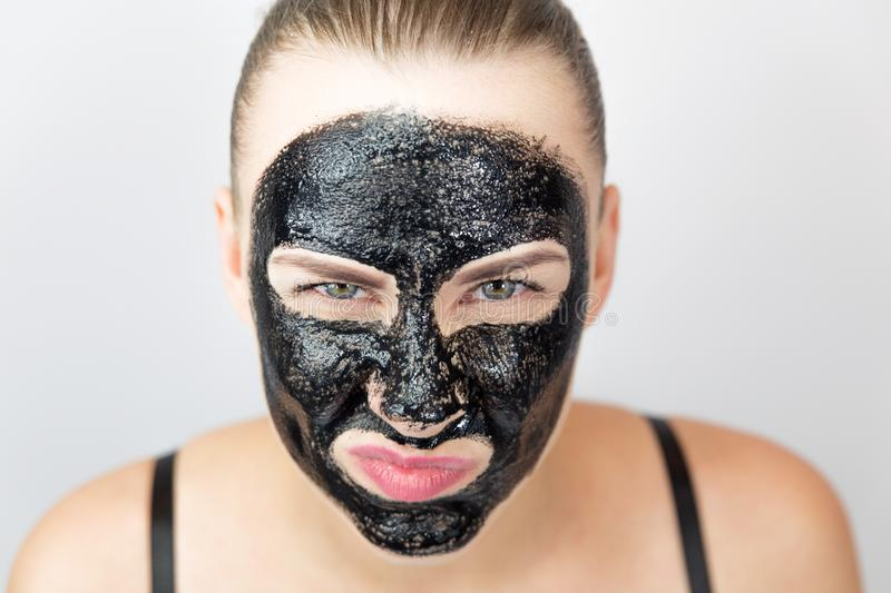 Black mask. Woman with purifying black mask on her face stock image