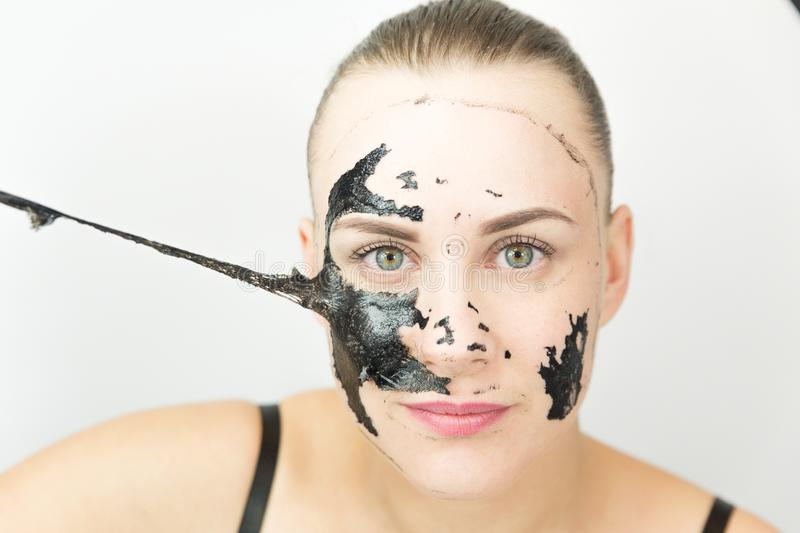 Black mask. Woman with purifying black mask on her face royalty free stock photography