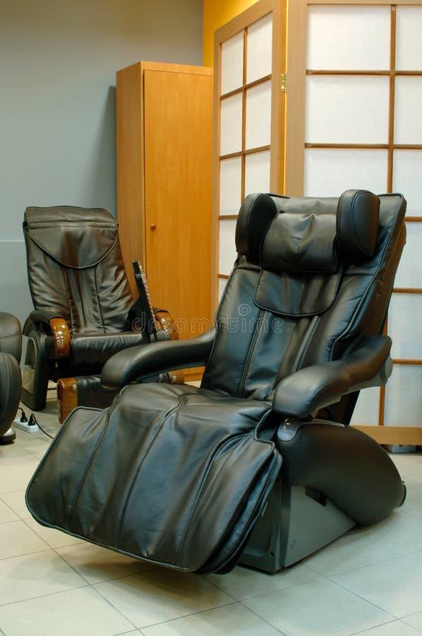 Black massage chair royalty free stock photos