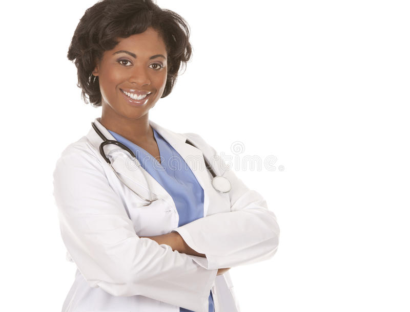 Black medical doctor. Black doctor wearing scrubs and lab coat on white isolated background stock photo