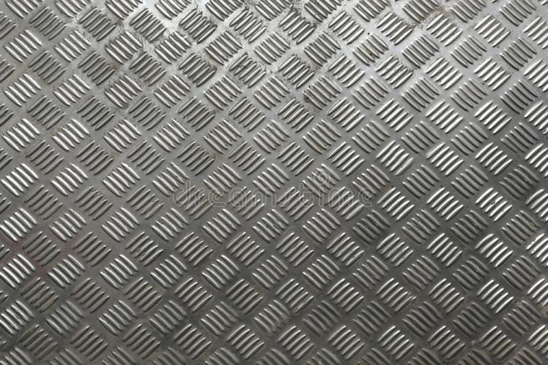 Black metal background and texture. diamond plate stock photos