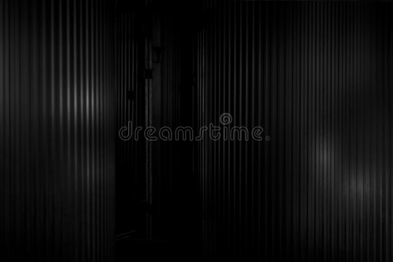 Black metal. Metal corrugated background with free space for text. Metal corrugated background with free space for text. Gray wavy grooved metal texture, copy royalty free stock photo
