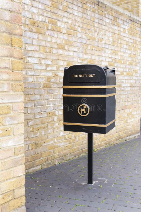 Black metal dog waste bin. On the street in England, UK stock image