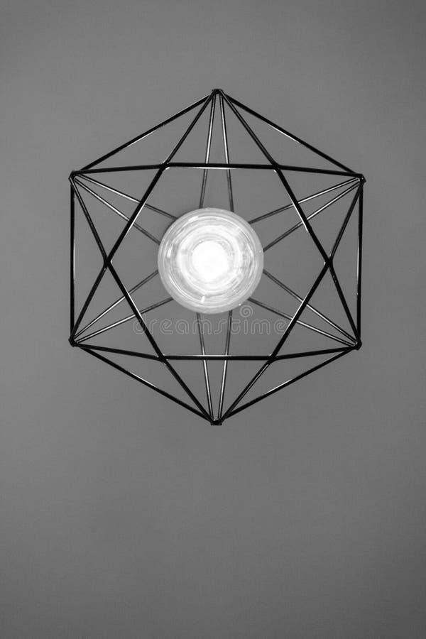 Black Metal Framed Pendant Lamp Turned-on royalty free stock images