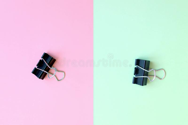 Paper clips on double background stock photo