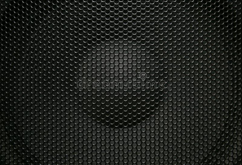 Metal perforated mesh, abstract pattern. Black metal perforated mesh, abstract pattern royalty free stock photography
