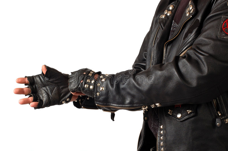 Black metall. Man's torso dreesed in black leather with metall, isolated on white royalty free stock photo