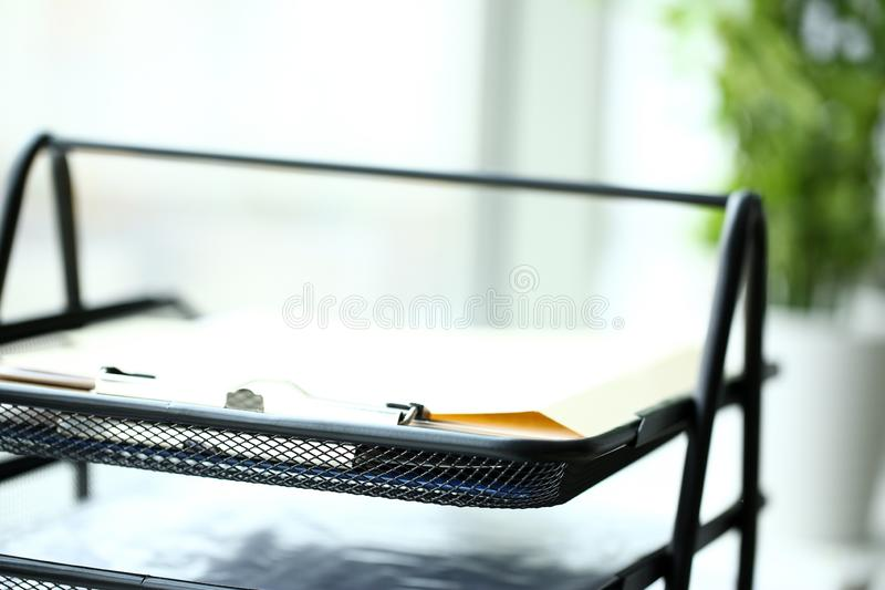 Black metallic multilevel office document tray stock photos