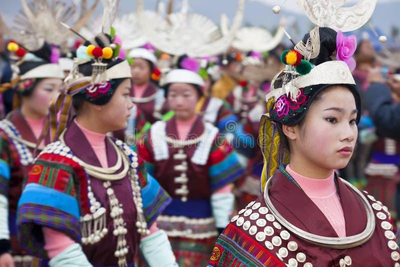 Black Miao girls dancing at festival, Kaili, Guizhou Province,. China stock photos