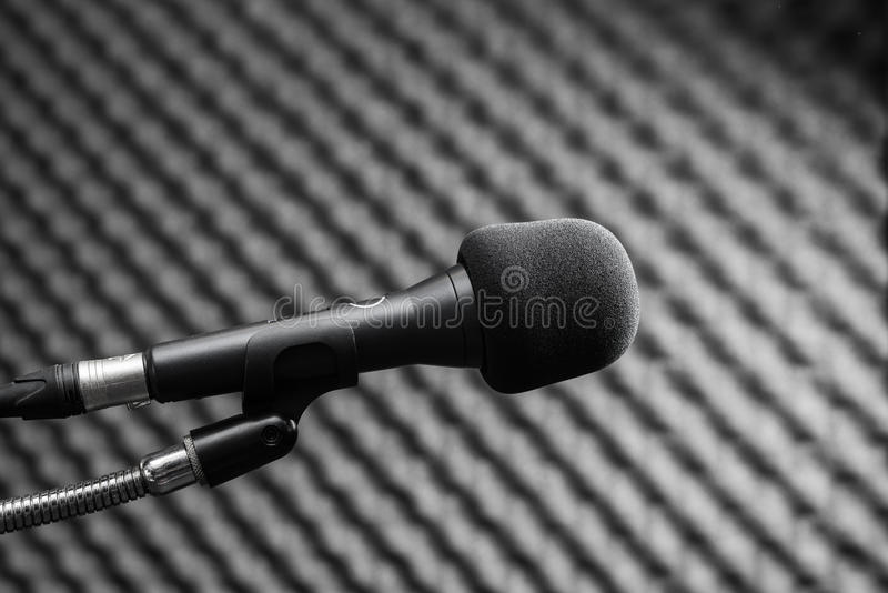 Black microphone in studio booth. Closeup of black microphone in studio booth stock photos