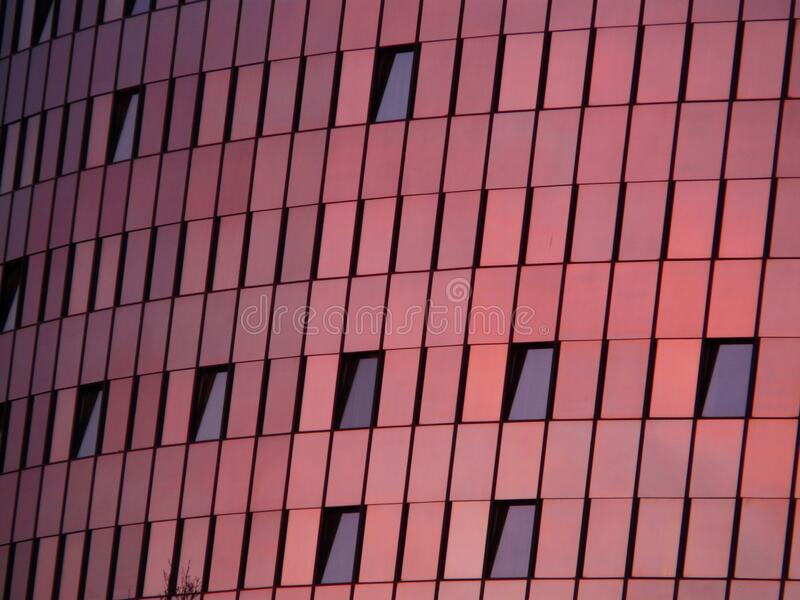 Black Mirror Mounted on Red Wall Building royalty free stock image