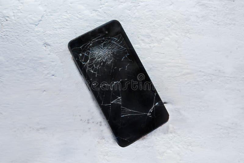 Modern broken mobile phone stock photo