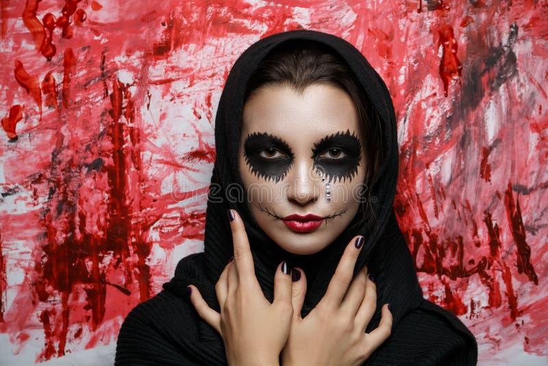 Black monk halloween. New creative make-up, conceptual idea for horror Halloween night party. White black color skull, tears, anatomy shape bones, cosmetics royalty free stock photo