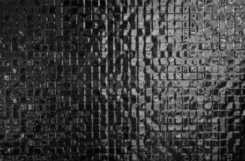 Black mosaic tiles pattern texture background Modern design. Home bathroom royalty free stock image