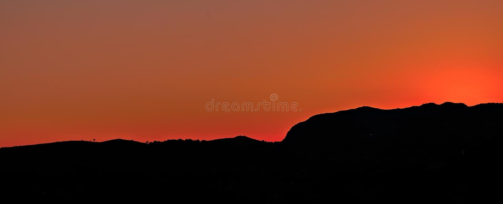 Black Mountain Under Brown Sky During Sunset Free Public Domain Cc0 Image