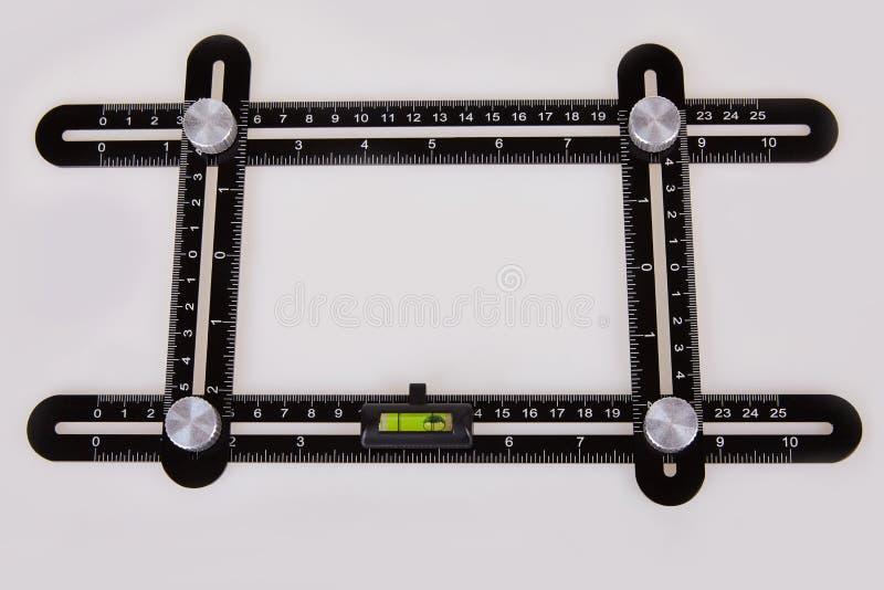 Black multi function Ruler isolated on white background. stock photos