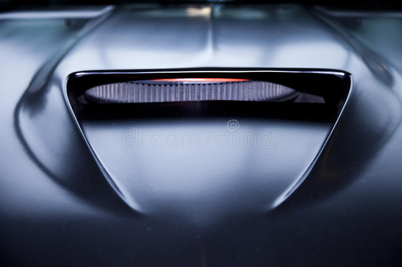 Black muscle car hood. Black muscle car fiber carbon engine hood vent. Front view royalty free stock photography
