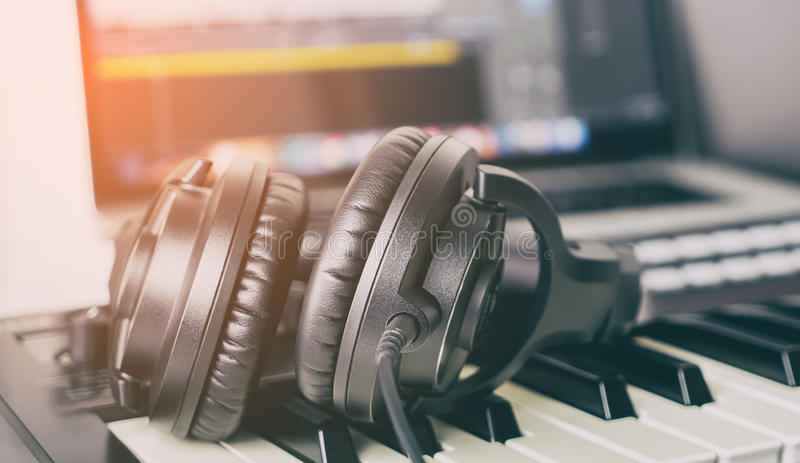 Black Music Studio headphone lying on music keyboard royalty free stock photos