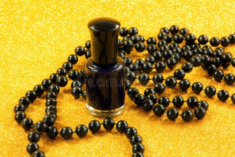 Download Black nail varnish stock photo. Image of beads, make - 36922196