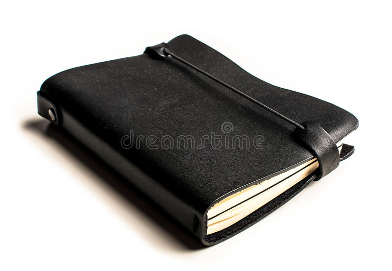 Black notebook with leather covers in perspective. A photography of a black notebook with leather covers shoot from a perspective angle stock photos