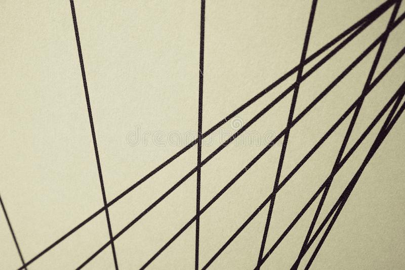 Black nteresting straight lines on a beige background, royalty free stock photo