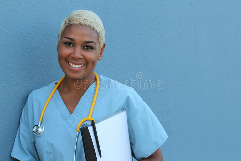 Black nurse isolated on blue stock photo