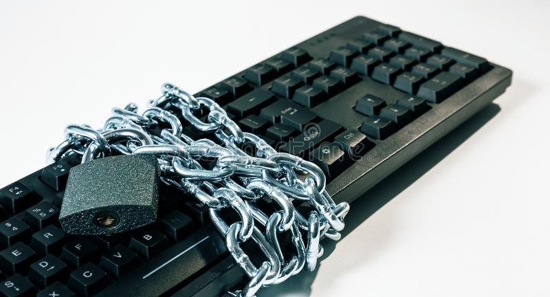 Protect hacker attacks concepts, cybersecurity metaphor. Black office computer keyboard with chain locked padlock, white background stock photos