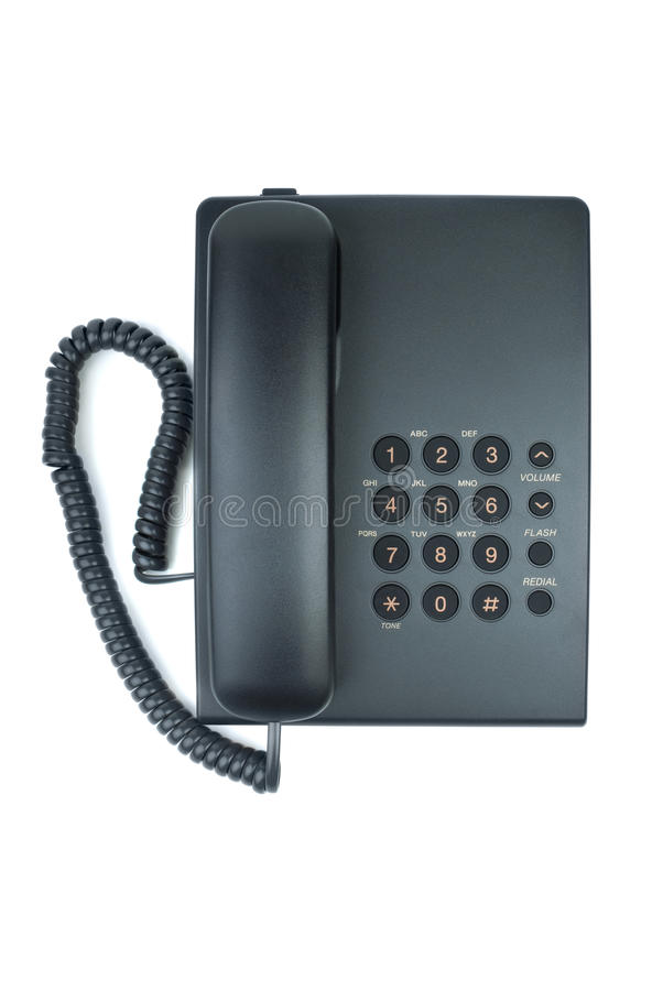 Black office phone with handset on-hook stock photo