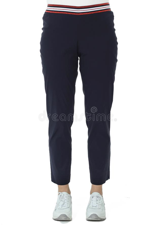 Black official trousers with belt on model legs with white stiletto heels. With bare toes royalty free stock photography