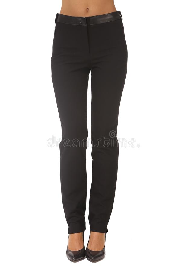 Black official trousers on model legs with white stiletto heels. With bare toes royalty free stock images