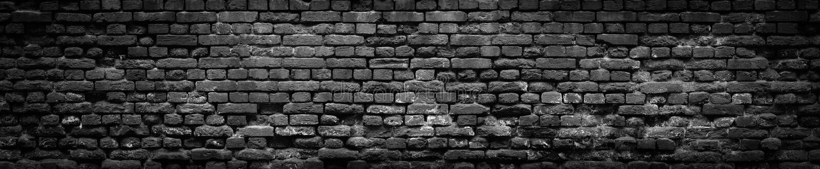 Black Old Brick wall panoramic background in high resolution royalty free stock image