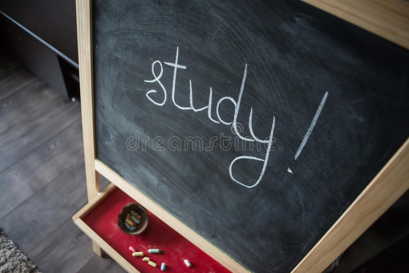 Black old empty chalkboard for copy space with colorful pieces of chalk. stock photo