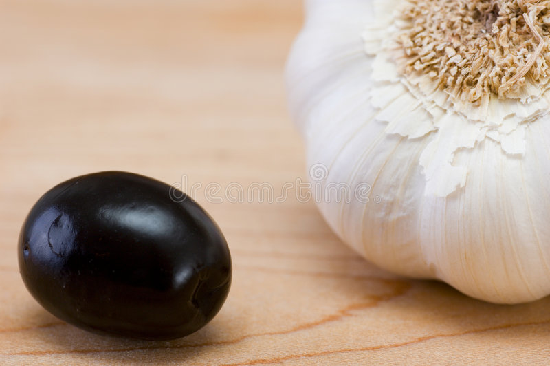 Black olive and garlic. Good for background stock images