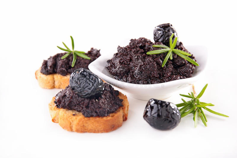 Black olive and tapenade. On wood background stock photos