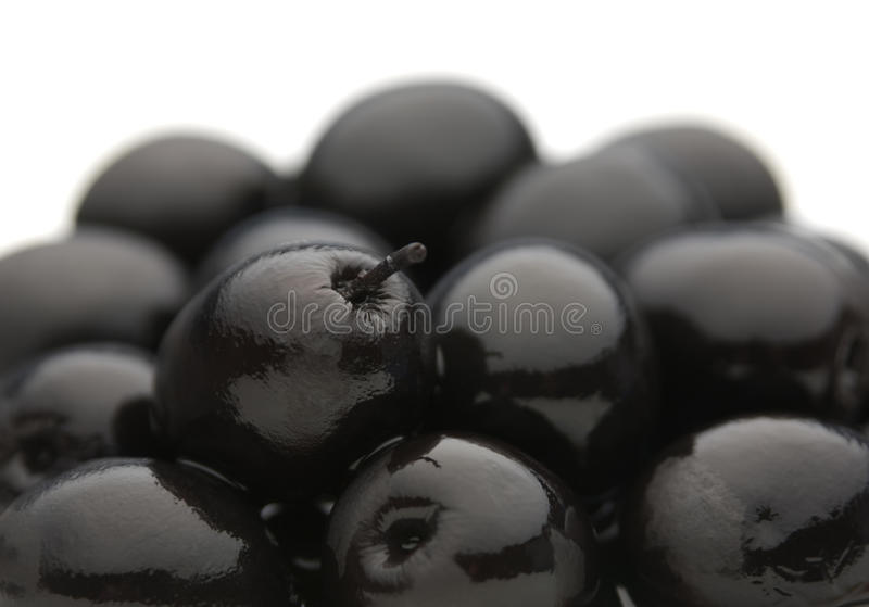 Black olive vegetable. Black salted olive vegetable closeup view background stock images