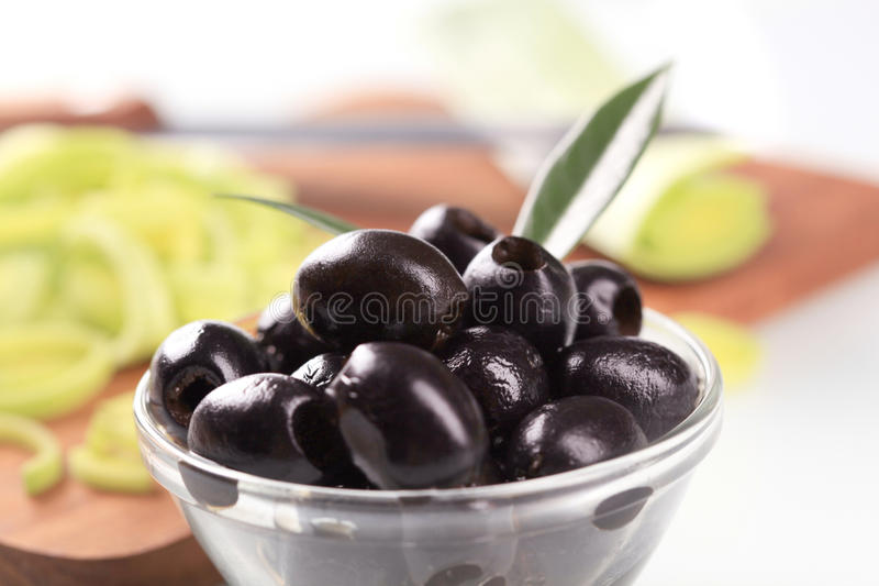Black olives. Bowl of black pitted olives royalty free stock photos