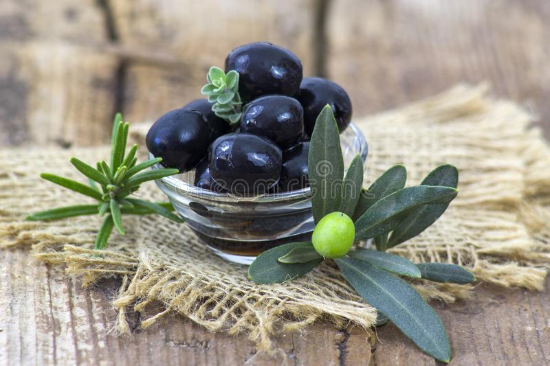 Black olives in a bowl stock photos