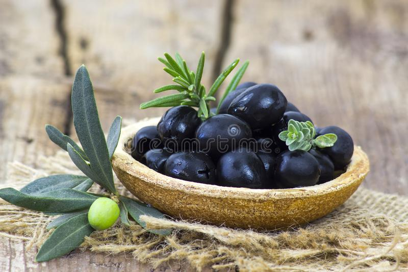 Black olives in a bowl royalty free stock images