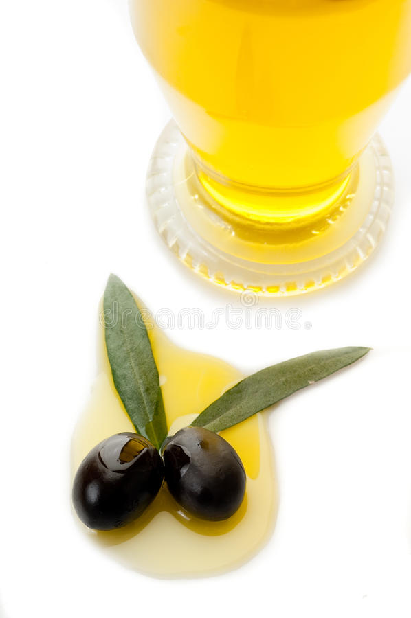Black olives with leaf and oil royalty free stock photo