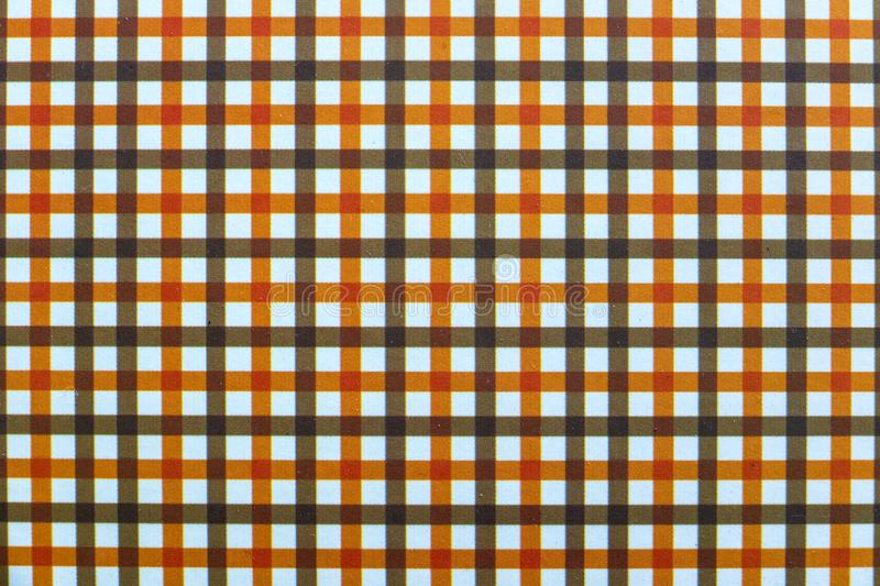 Black and Orange Checkered Seamless Texture of Wallpaper royalty free stock images