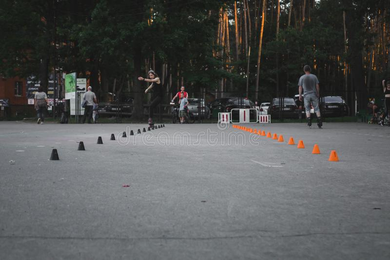 Black and orange cones for rollerblading in the park. Skating, child, sport, kid, activity, fun, leisure, slalom, training, active, inline, outdoors, roller stock images