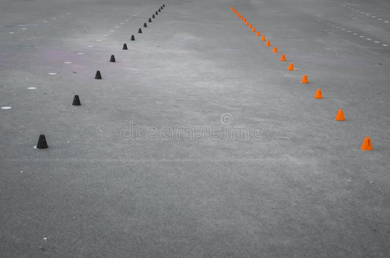 Black and orange cones for rollerblading in the park. Skating, child, sport, kid, activity, fun, leisure, slalom, training, active, inline, outdoors, roller stock photography