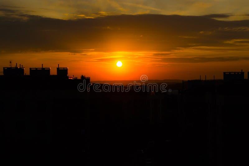 Beautiful sun set. Black-orange sun set in city stock photography