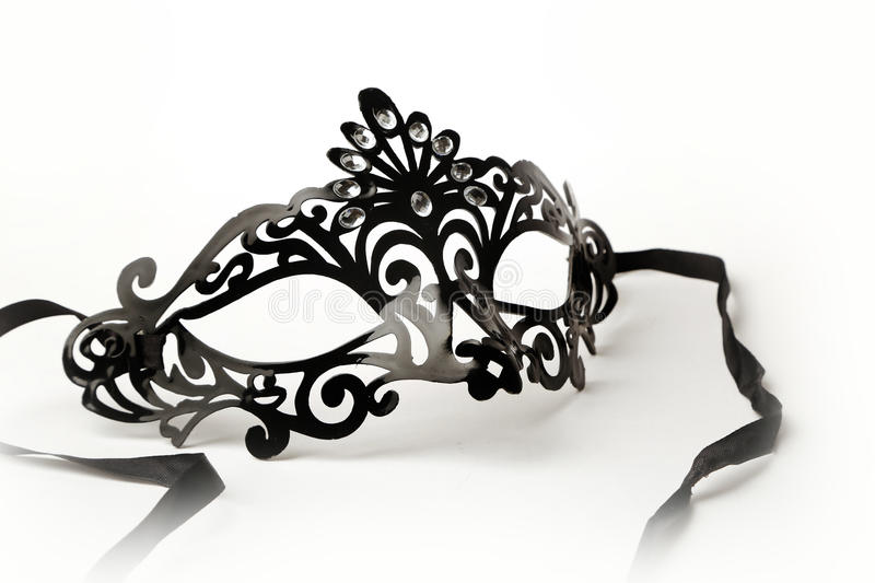 Black Ornate Masquerade Mask on White Background. Photos of beautiful Black ornate masquerade mask on white background perfect for parties and celebrations and royalty free stock image