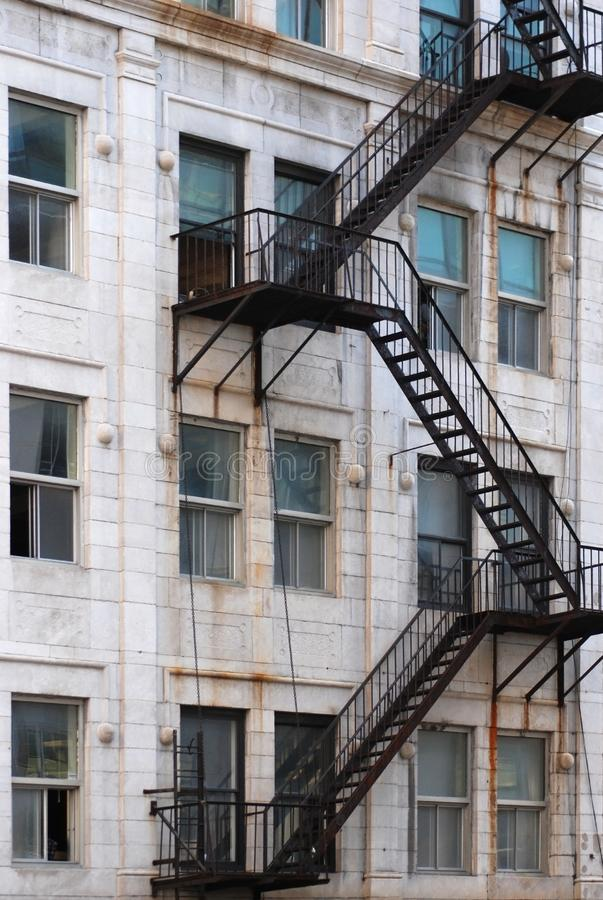 Black Outdoor Emergency Stairs for an Old City Building. Vertical stock photo