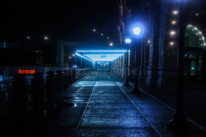 Black Outdoor Pedestal Lamp Near Coaster Train Rail royalty free stock image