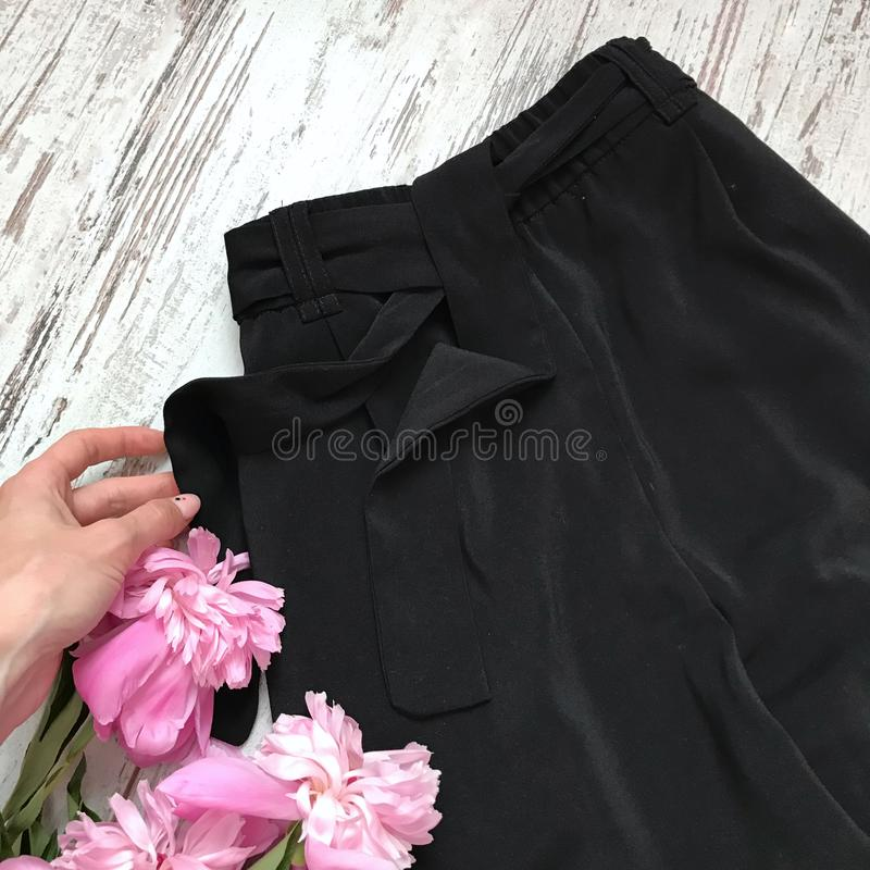 Black pants close-up on a wooden background royalty free stock photography